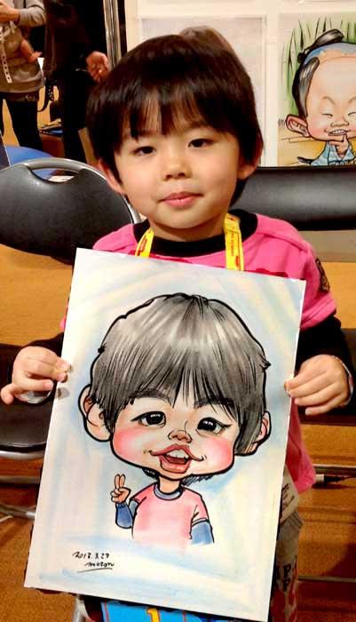 ピースサインをした男の子の似顔絵